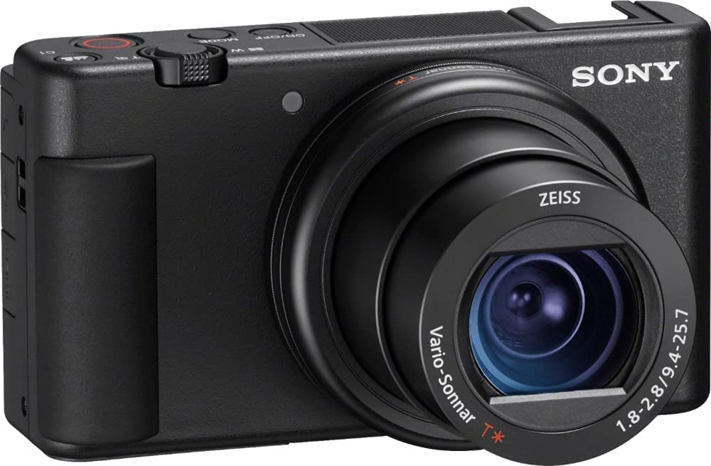 It has a new and novel directional microphone next to the flash hotshoe and there's a fully articulating touchscreen display. Although the Sony ZV-1
